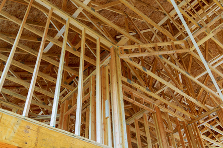 Inside the house with wooden frames under construction