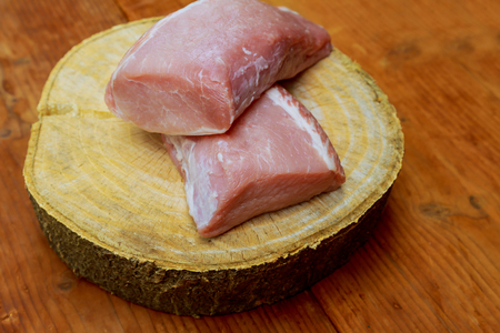 Raw Organic Boneless Pork Chops Ready to Cook Pieces of pork on a cutting board
