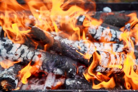 snug: fire wood Warm orange bonfire with pieces of wood Stock Photo