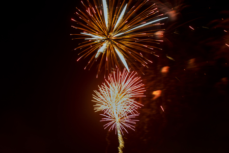 pyrotechnics: Brightly colorful fireworks and salute of various colors in the night sky, copy space.
