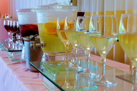 degustation: Glasses with wine on table - party background