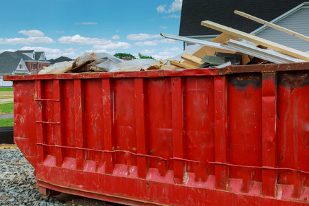 dumpster: Dumpster with left over wood from construction Stock Photo