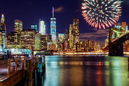 Firework over city at night with reflection in water Fireworks on the background of New York
