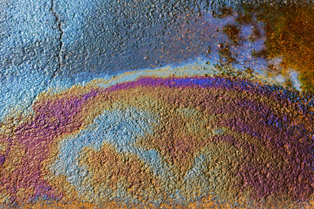 Background of an oil slick on the road. Oil slick on the road.