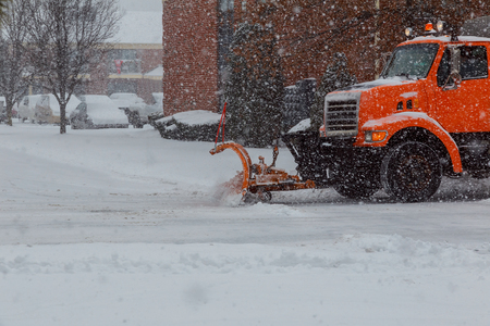Snow plow doing removal after a blizzard in suberb.