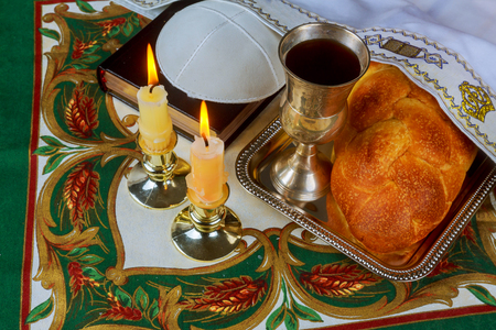 Jewish holiday Sabbath image. matzoh jewish passover and candelas on wooden table
