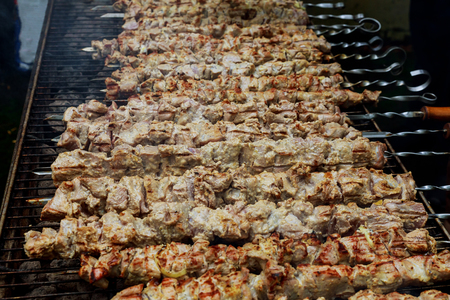 delicious grilled meat over the coals on a barbecue or on the flaming grill kebab, on skewer with