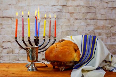 Jewish Holiday Hanukkah background with menorah wood dreidel tradition Stock Photo