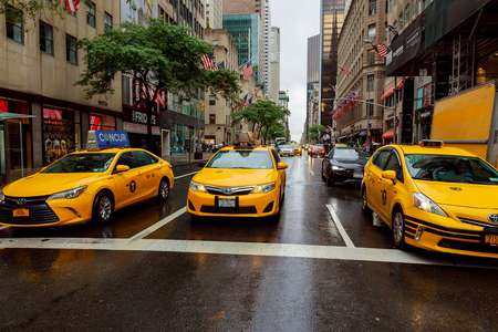 NEW YORK - JULY 2017: Taxi cars in Times Square, a busy tourist intersection of commerce Advertisements and a famous street of New York City and US, seen on June in New York, NY. Sajtókép