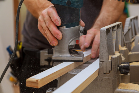 Carpenter milled wood upper hand electric router wood Router base plate Archivio Fotografico
