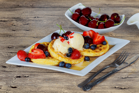 Wafers with blueberries of strawberries and ice cream Mixed fruits waffle with ice cream