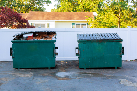 disposed: Dumpsters being full with garbage container Over flowing