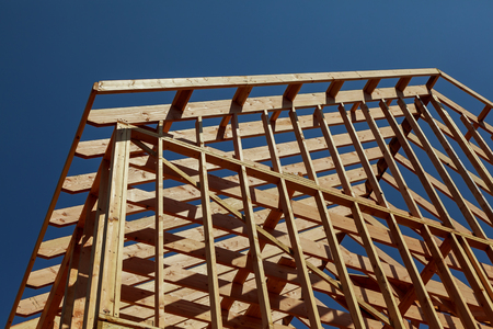 Interior framing of a new house under construction Stock Photo