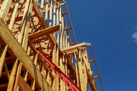 buildingsite: New Houses Being Built In North America the seeming chaos of a house frame being constructed