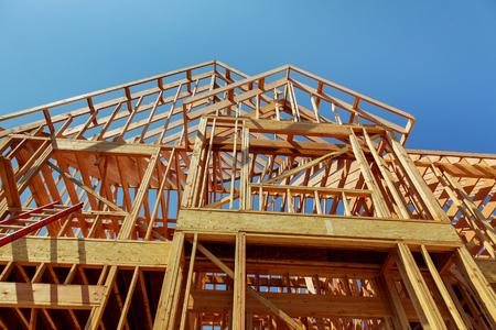 housebuilding: wood framework of new residential home under construction. Home Under Construction Stock Photo