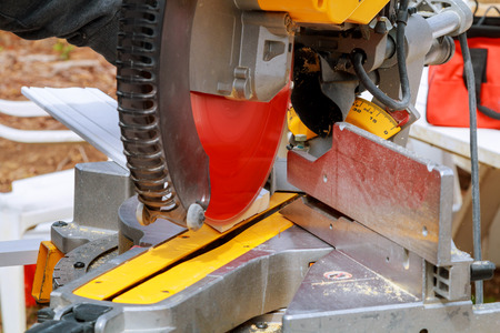 dirty: Circular Saw. Carpenter Using Circular Saw for wood Man, worker sawing wood with a circular saw,