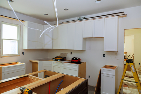 Installation of kitchen cabinets the drawer in cabinet.