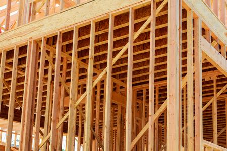 wood framework of new residential home under construction. Home Under Construction Stock Photo