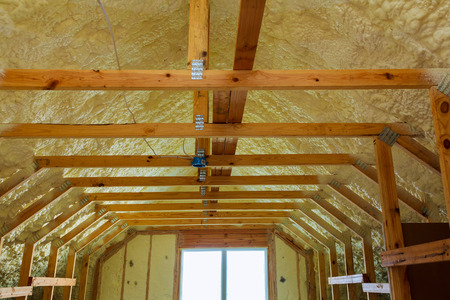 thermal and hidro insulation with spray foam at house construction site,