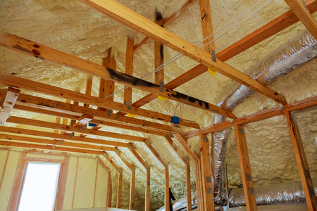 thermal and hidro insulation Inside wall insulation in wooden house, building under construction Standard-Bild