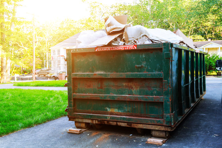 Dumpsters being full with garbage in a city. Dumpsters being full with garbage Stock Photo