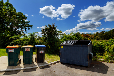 disposed: Dumpsters being full with garbage Dumpsters being