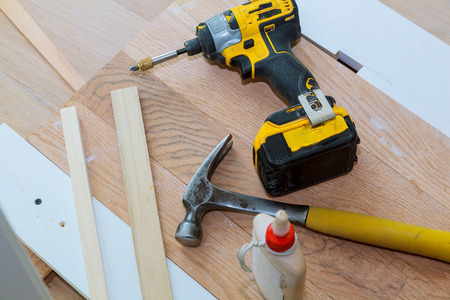 carpenter tools on wooden background tool drill hammer glue Reklamní fotografie
