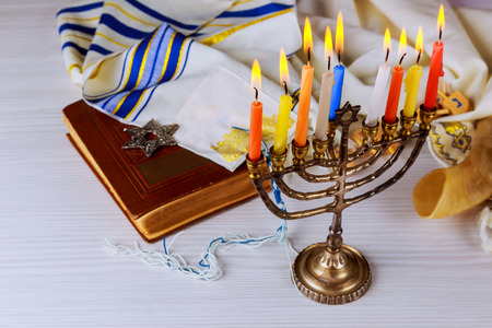 Jewish holiday hannukah symbols - menorah. Copy space background. Stock Photo