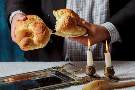 hasidism: Sabbath image candlesticks with lit candles, and challah, kiddush, sabbath, food, jewish kosher prayer Stock Photo