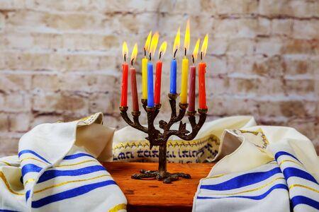 Hanuka menorah with burning candles. Jewish holiday hannukah challah bread