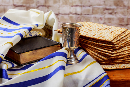 Pesah celebration concept jewish Passover holiday . Traditional book with text in hebrew: Passover Haggadah Passover Tale