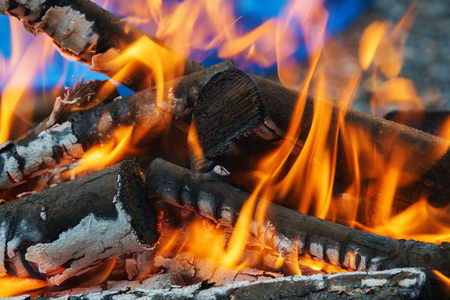 smolder: three burning billets in hot stove fire wood Stock Photo