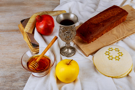 ceremony of the meeting shofar, torah book, honey, apple and pomegranate the jewish new year Stock Photo