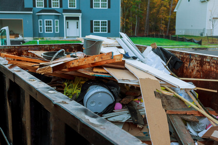 Loaded dumpster near a construction site, home renovation dumpster filled with building rubble dumpster