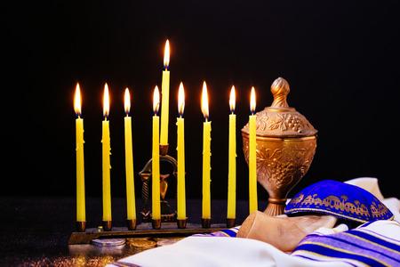 Low key Image of jewish holiday Hanukkah background with menorah traditional candelabra and burning candles Stock Photo