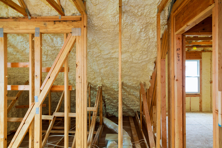 thermal and hidro insulation Inside wall insulation in wooden house, building under construction Stock Photo