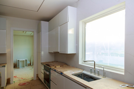 Interior design construction of a kitchen with cooker extractor fan hood 스톡 콘텐츠
