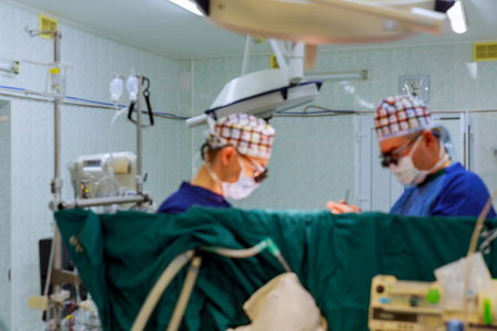 Soft natural background. Surgeon during an operation on the open heart 스톡 콘텐츠