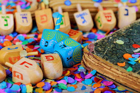 Jewish holiday wooden dreidels spinning top for hanukkah jewish holiday over glitter gold background Stock Photo