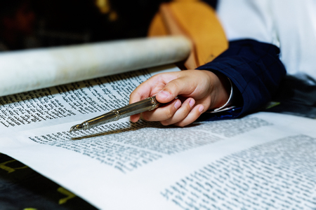 Bar Mitzvah celebrations, ceremonial reading from the Jewish religious book called Torah. Stock Photo