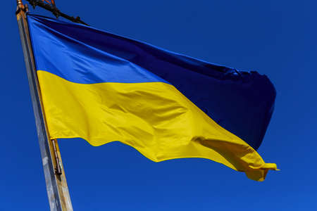Flag of Ukraine on the background of the blue sky Flag of Ukraine on blue sky background.