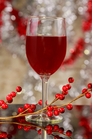 Christmas mulled wine with attributes on a wooden table glass of wine a Christmas