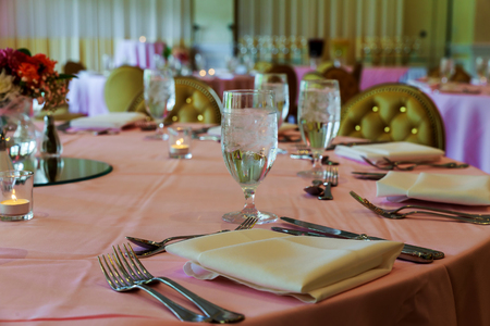 catering table set service with dish silverware and stemware glass at restaurant before party Stock Photo