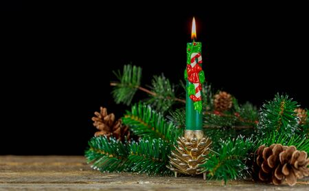 New Year composition. Holiday decorations and burning candles of christmas candle Imagens