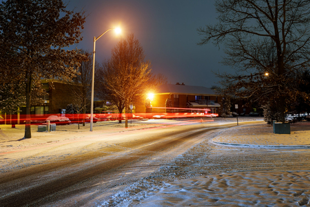Winter fairy. Night shot of country street under snow in winter season. winter night snow dwelling area