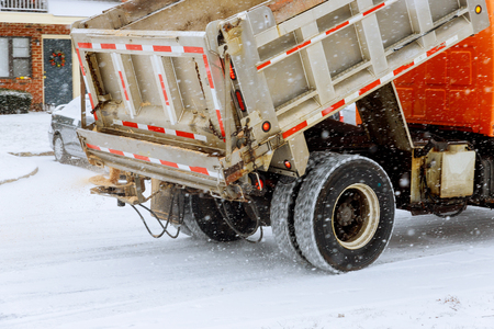 working machine for sprinkling sand roads during snowfall and ice Stock Photo