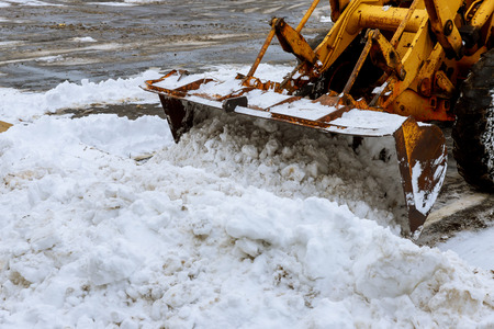 Snow cleaning process in winter in the city Cleaning road from snow storm. Stock Photo