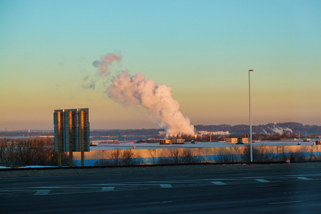 Thick smoke from thermal power plants over the residential areas of the city. Power generates electricity Stock Photo