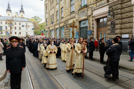 LVIV, UKRAINE - October 16, 2017: Holy Week Procession believers during the cross march marking the religious holiday of the sacred the Cross Sunday in Lviv. Crowd of religious people