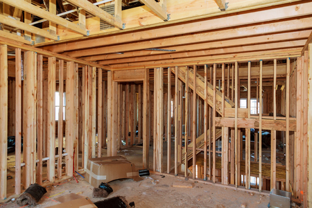 Wood framing work in progress with wood framing walls and ceiling or floor joist on a new construction building 스톡 콘텐츠